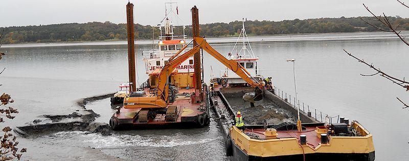 multicat with dredge excavator-loading split hopper barge