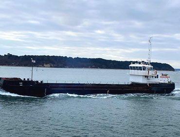 Split Hopper Barge transporting silt from dredging site