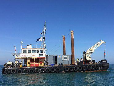 Avon multicat with 15t crane and 15m spud legs