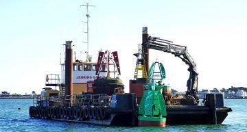 Stour workboat deploying new navigation marker Poole harbour