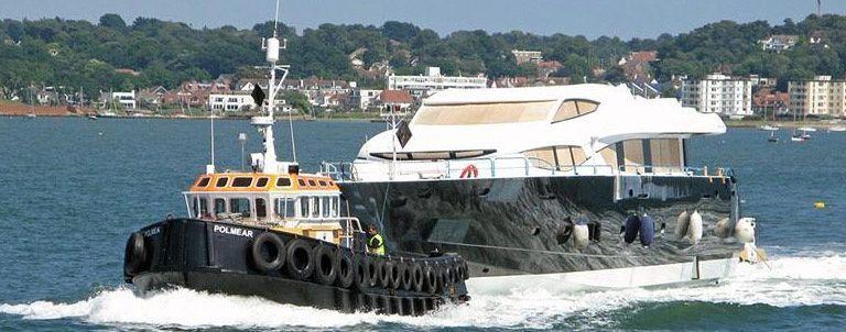 polmear tugboat tows sunseeker yacht