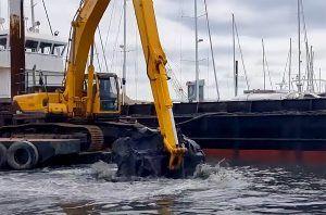 dredging underway at Haslar Marina with hopper barge nab
